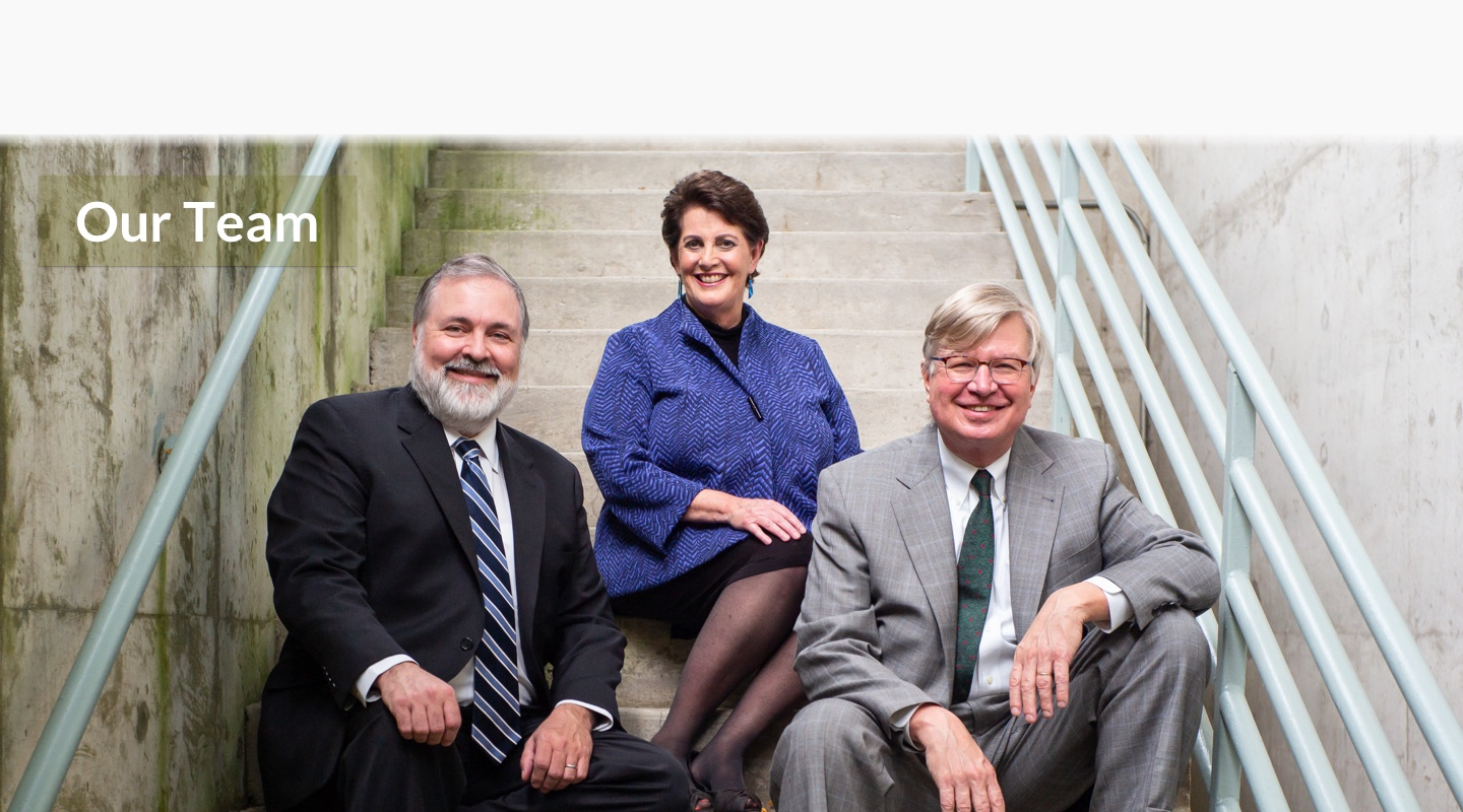 Group photo of the lawyers of Dugan, Babij, Tolley & Kohler